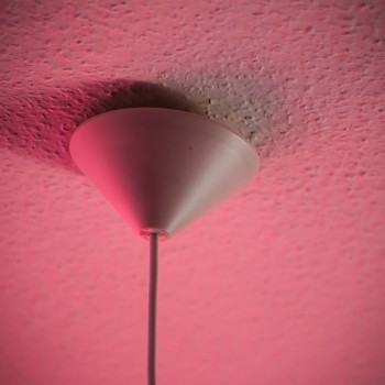 Conceptual shot of lamp part at the ceiling