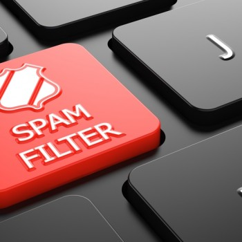 Spam Filter with Shield Icon - Red Button on Black Computer Keyboard.