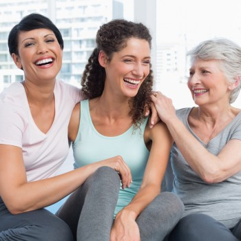 Cheerful fit women sitting in the yoga class