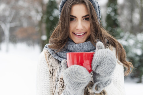 Winter woman with cup of hot tea