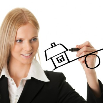 Businesswoman drawing a mortgage illustration. Isolated on white