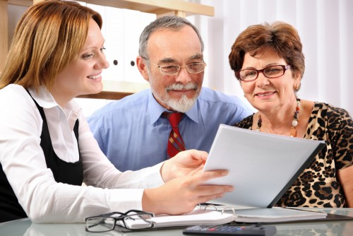 Senior couple meeting with agent or financial advisor