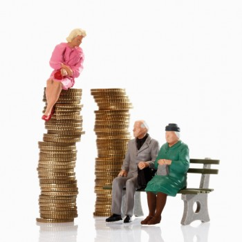 Figurines of old age pensioner sitting on bench,beside young woman figurine sitting on coin stack